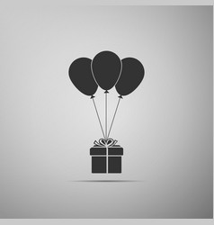 gift box with balloons icon on grey background vector image
