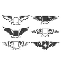 Shield with wings set vector