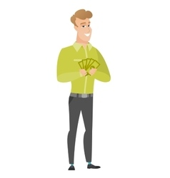 Happy caucasian businessman holding money vector