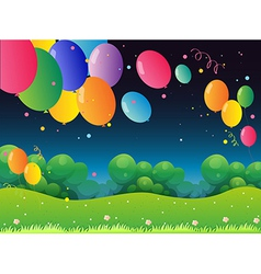 Colorful flying balloons at the hill vector