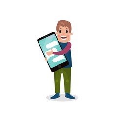 Young man holding giant smartphone internet vector