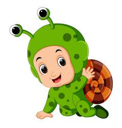 Cute boy cartoon wearing snail costume vector
