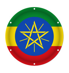round metallic flag of ethiopia with screw holes vector image