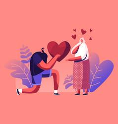 Loving boyfriend presenting huge heart vector