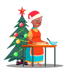 old woman makes christmas cookies in the kitchen vector image