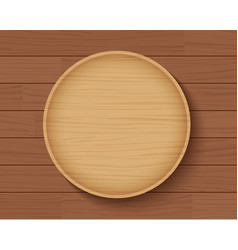 Wooden plate on wood table background vector
