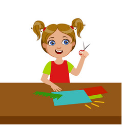 girl cutting grass shape for applique elementary vector image
