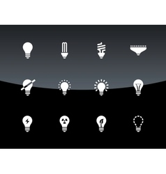 Light bulb and CFL lamp icons on black background vector image