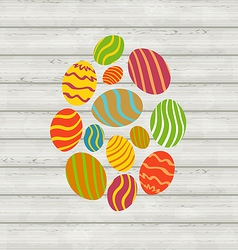 Easter ornamental eggs on wooden background vector image