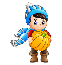 Cartoon little boy holding a pumpkin vector