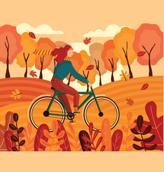 Happy young woman riding a bike autumn vector