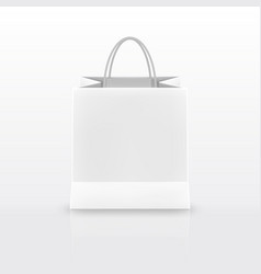 Realistic white paper shopping bag with handles vector