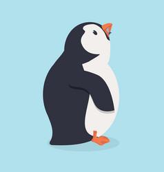 penguin bird eating fish vector image