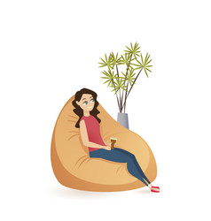Young woman sitting calm in brown beanbag chair vector