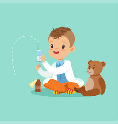 Adorable baby boy dressed as a doctor playing with vector