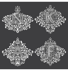 Set of ornamental monogram in coats of arms form vector image