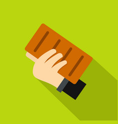 hand holding a brick icon flat style vector image vector image