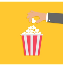popcorn and hand Flat vector image vector image