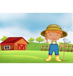 A farmer holding hoe vector
