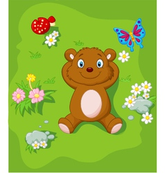 Cartoon bear lying down on the grass vector