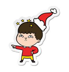 Sticker cartoon of a amazed boy wearing santa hat vector