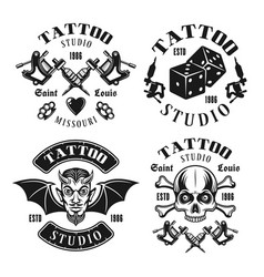 Tattoo studio four black vintage emblems vector