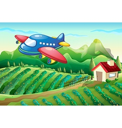 An airplane above the farm with a house vector