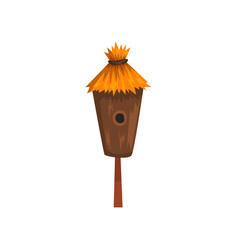 Bird house with a thatched roof nesting box vector