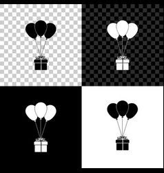 gift box with balloons icon isolated on black vector image