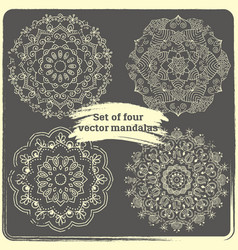 Set of 4 hand drawn mandalas vector