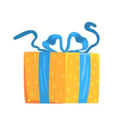 yellow gift box with blue ribbon cartoon vector image vector image