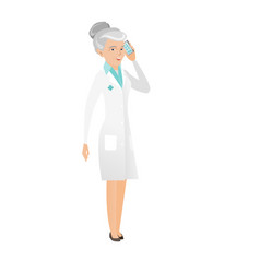 Senior caucasian doctor talking on a mobile phone vector