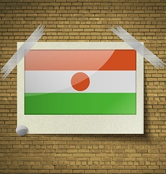 Flags Niger at frame on a brick background frame vector image vector image