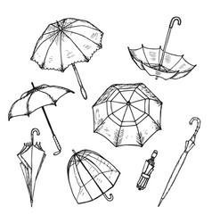 Hand drawn umbrellas set vector