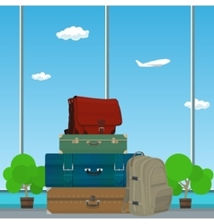 Suitcases and Bag against the Window vector