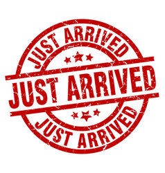 just arrived round red grunge stamp vector image