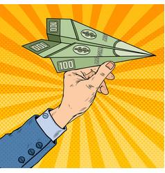 pop art hand throwing dollar paper plane vector image