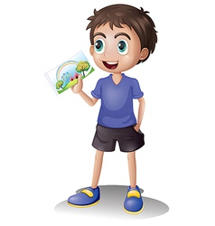A young man holding a picture vector image vector image