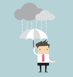 Businessman under an umbrella in the rain vector image