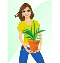 smiling woman holding chlorophytum vector image vector image