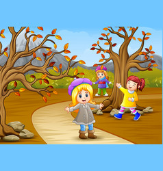 happy kids playing in the autumn park vector image