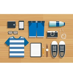 Teenage travel accessories on wooden flat design vector