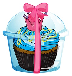 A cupcake container with a pink ribbon vector image vector image