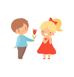 Adorable little boy giving red tulip flower to vector