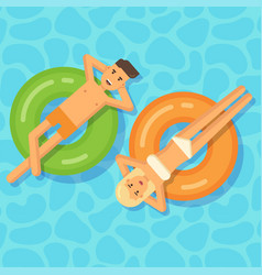 man and woman floating on inflatable circles vector image