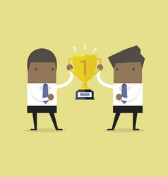 businessman holding gold winner cup together vector image