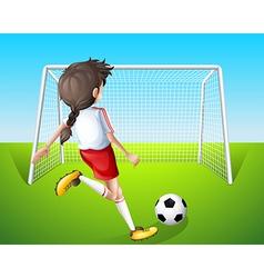 A girl practicing soccer vector