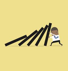 Businessman pushing falling deck domino tiles vector