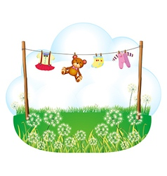 Baby things hanging above the weeds vector image