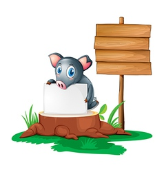 A pig holding an empty paper on a stump beside an vector image